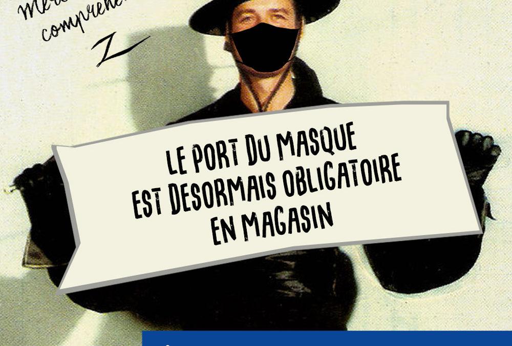 zorro porte un panneau pour promouvoir le masque obligatoire